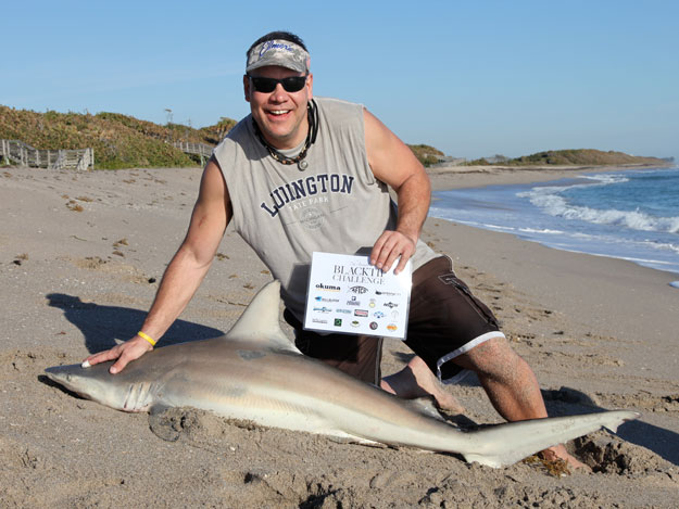 Kevin Raes with a blacktip shark caught in the 2015 Blacktip Challenge